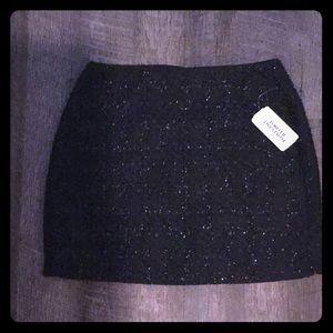 New glittery black mini skirt
